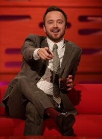 Aaron Paul opts for burgundy socks