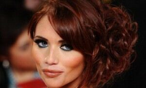 Amy Childs attends shop opening in slinky black leggings