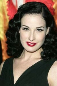 Dita rolls on stockings for charity shoot