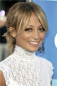 Nicole Richie: Tights are a staple for my look