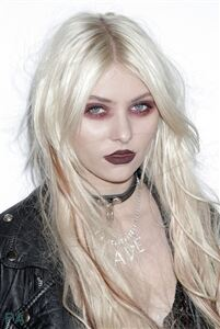 Taylor Momsen wears ripped tights for gothic effect