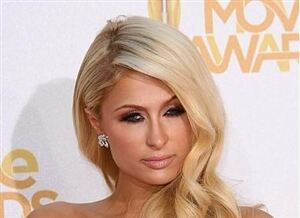 Paris Hilton wears black tights for sophisticated look
