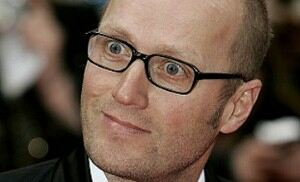 Ade Edmondson a 'bald, bespectacled swan' in tights