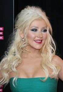 Christina Aguilera pairs hotpants with shiny tights
