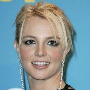 Britney Spears returns in fishnet tights