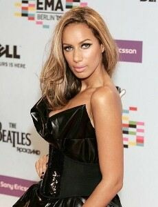 Leona Lewis pairs black tights with peep-toe shoes