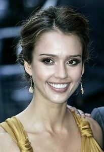Jessica Alba wraps up in big brown scarf