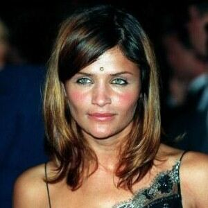 Helena Christensen dons blue tights for fashion event