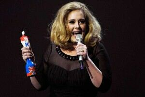 Adele shows off trim figure in leggings