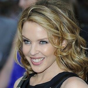 Kylie Minogue teases in fishnet tights