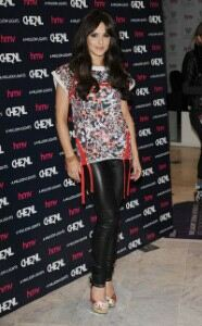 Cheryl Cole promotes album in leather leggings