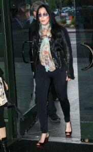 Cher rolls back the years in leggings