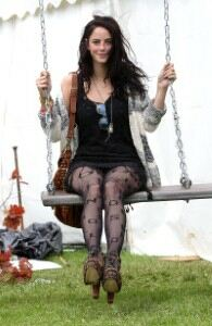 Kaya Scodelario braves mud at Isle of Wight festival
