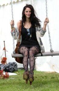 Kaya Scodelario braves mud at Isle of Wight festival