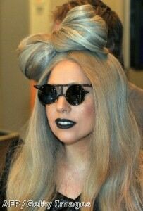 Lady Gaga slips into fishnet tights for date night