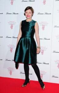 Camilla looks glam in black tights