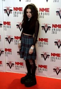 Charli XCX works laddered tights