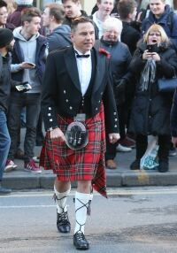 Cheeky Cowell lifts Walliams' kilt