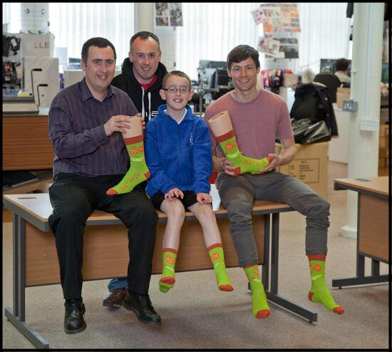Elliot (centre) visited SockShop HQ with his Dad and Uncle to be shown around by one of our designers, Craig (far right)