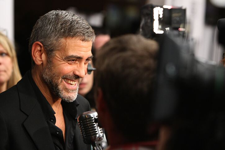 George Clooney is happy to spread the sock wealth