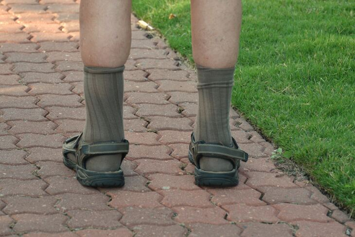 Man wearing socks and sandals